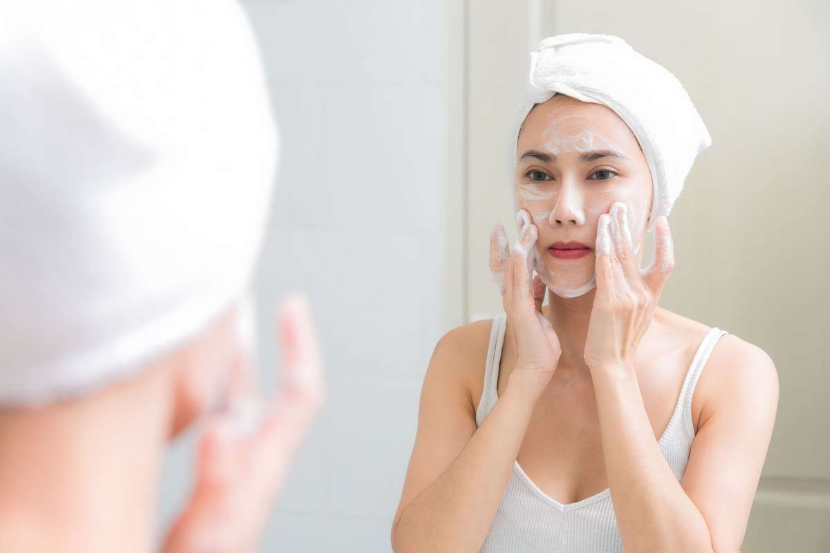 washing face with acne